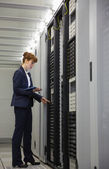 Technician working on servers using tablet pc — Stock Photo