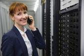 Smiling technician talking on phone — Stock Photo