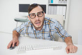 Nerdy stressed businessman working on computer — Stock Photo