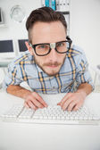 Nerdy businessman working on computer — Stock Photo