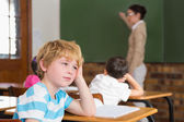 Pupil not paying attention in classroom — Stock Photo