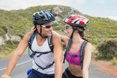 Athletic couple mountain biking — Foto Stock