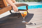 Tropical juice by swimming pool — Stock Photo