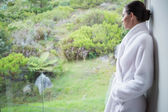 Relaxed woman wearing a bathrobe — Stock Photo