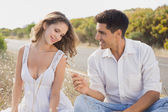 Couple sitting on countryside landscape — Stock Photo