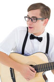 Nerdy hipster playing the guitar — Stock Photo