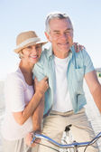 Happy senior couple going for a bike ride — Stock Photo