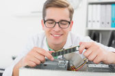 Smiling technician working on broken cpu — Foto Stock