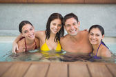 Cheerful people in the swimming pool — Stockfoto