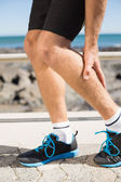 Fit man gripping his injured calf muscle — Stock Photo