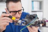 Computer engineer working on cpu — Stockfoto