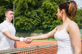 Tennis opponents shaking hands before match — Stock Photo