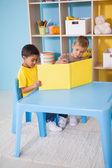 Little boys reading at desk — Stock Photo