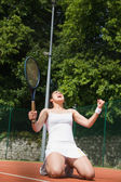 Pretty tennis player celebrating a win — Stock fotografie
