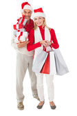 Festive couple holding presents and shopping bags — ストック写真