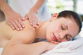 Attractive woman receiving shoulder massage at spa center — Стоковое фото