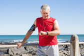 Fit mature man warming up on the pier — Foto Stock