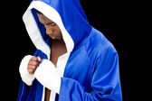 Muscular boxer in in blue hood — Stock Photo