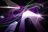 Purple light beams over skyscrapers — Stock Photo