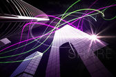 Purple light beams over skyscrapers — Stock Photo