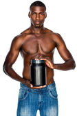 Sporty man holding protein drink — Stock Photo