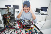 Confused computer engineer working — Stock Photo