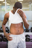 Fit man wiping sweat after workout — Stok fotoğraf
