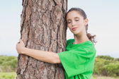 Female environmental activist hugging tree trunk — Stock Photo