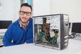Computer engineer smiling at camera — Stock Photo