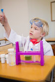 Pupil dressed up as scientist in classroom — Stockfoto