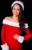 Pretty brunette in santa outfit smiling at camera — Stock Photo