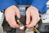 Computer engineer working on broken cable — Stock Photo