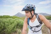 Athletic young man mountain biking — Stock Photo