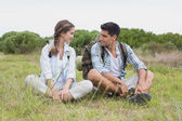 Couple taking a break on landscape — Stock Photo