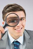 Empresario mirando con lupa — Foto de Stock