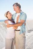 Happy senior couple embracing on the pier — Stock Photo