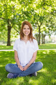 Pretty redhead in the park — ストック写真