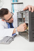 Computer engineer working on broken console — Stock Photo