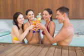 People toasting drinks in the swimming pool — Stock Photo