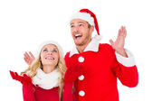 Festive couple smiling and looking up — Stock Photo