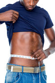 Fit man measuring waist — Stock fotografie