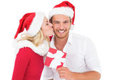 Festive young couple exchanging presents — ストック写真