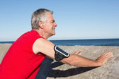 Active senior man stretching before a jog — Stock Photo