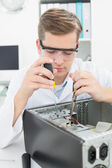 Computer engineer working on broken device — Stock Photo