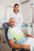 Patient and dentist smiling — Stock Photo