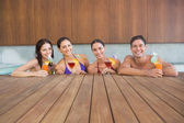 People with drinks in swimming pool — Stock Photo