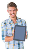 Handsome young man showing his tablet pc — Stock Photo