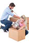 Young couple packing moving boxes — Stock Photo