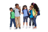 Schoolchildren wearing backpacks — Stock Photo