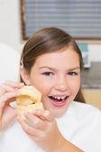 Girl holding model teeth — Stock Photo